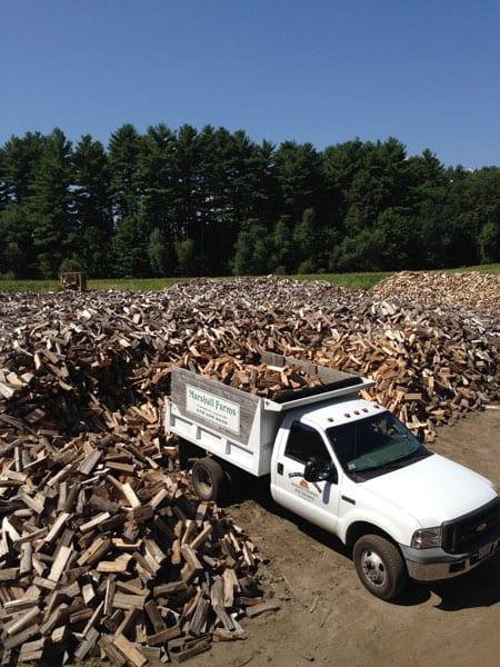 Truck unloading firewood