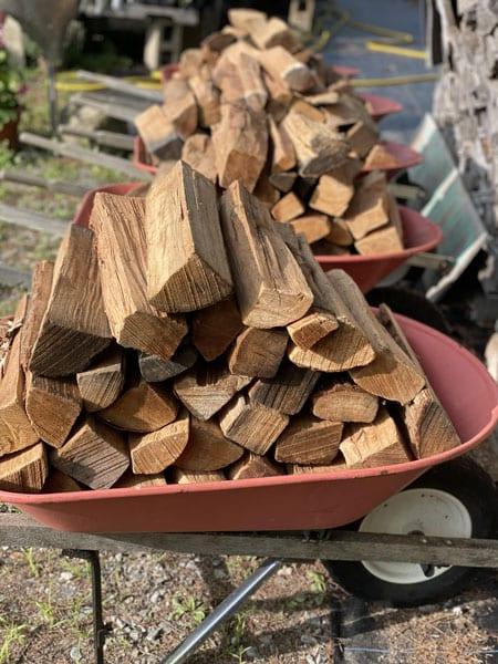 Firewood in wheelbarrows
